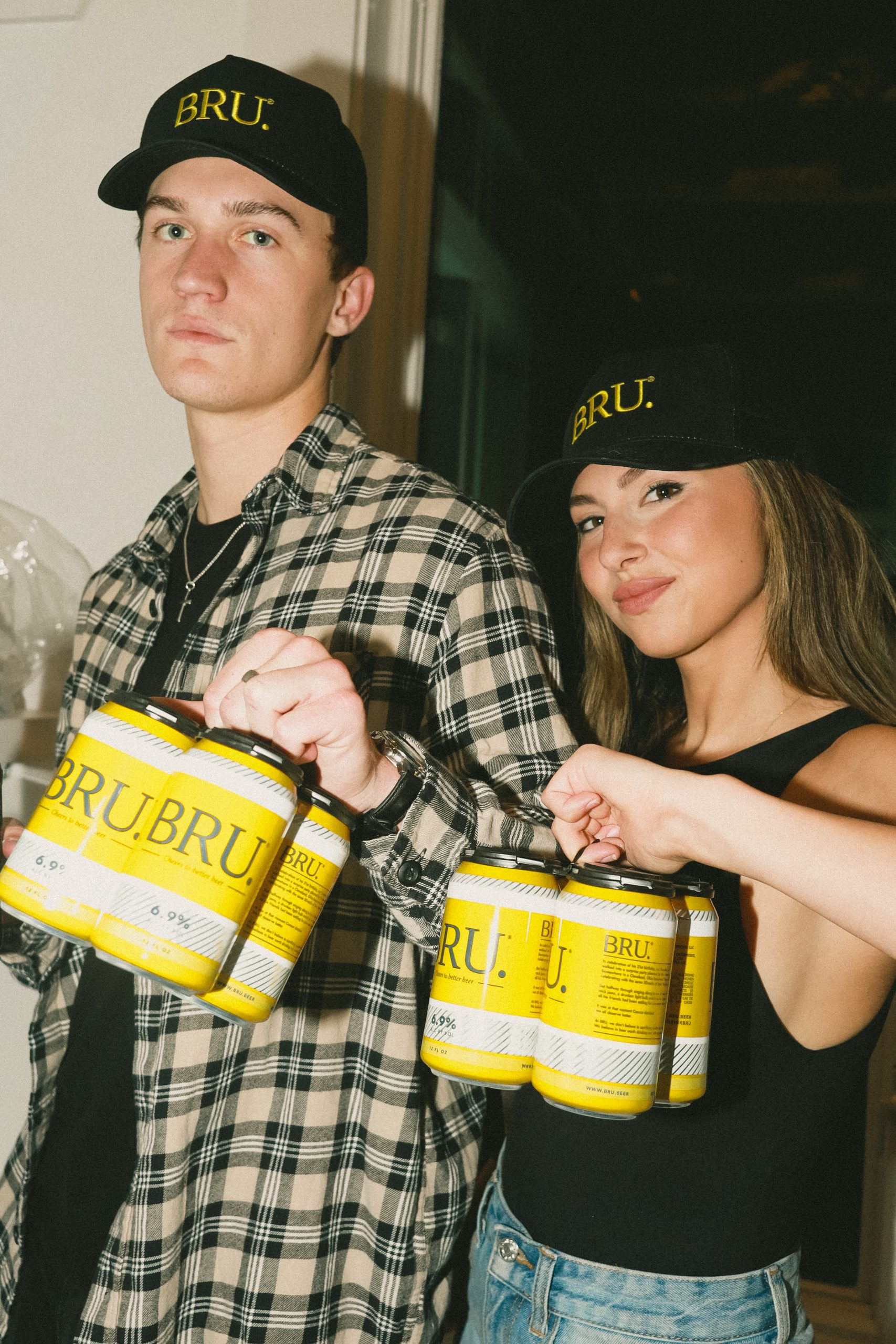 Will Hobick & Woman Holding BRU Beer